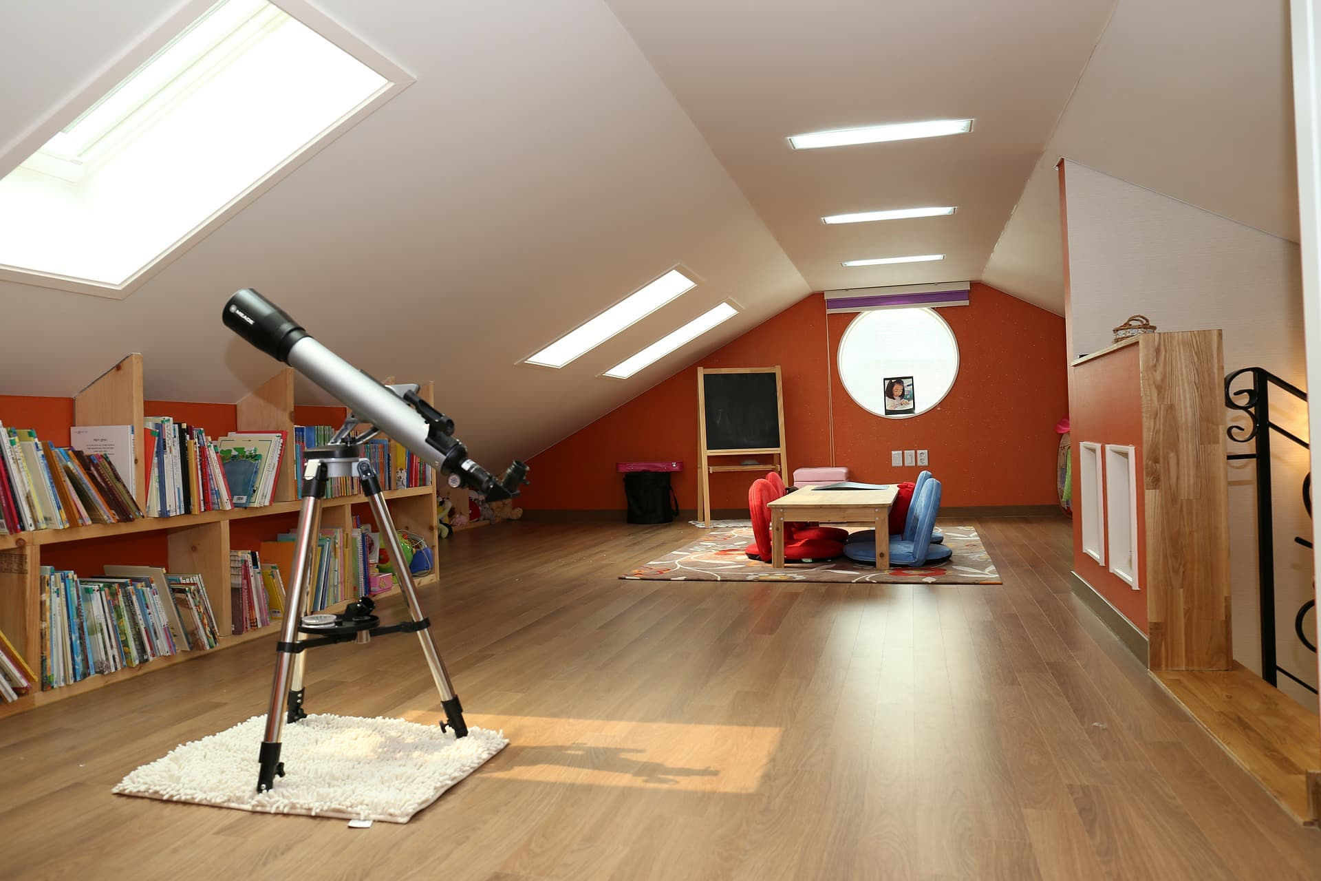 loft room with telescope