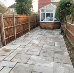 block patio with fence on the side
