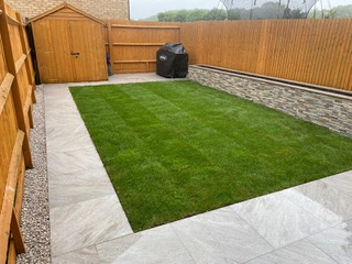 patio and lawn with garden shed