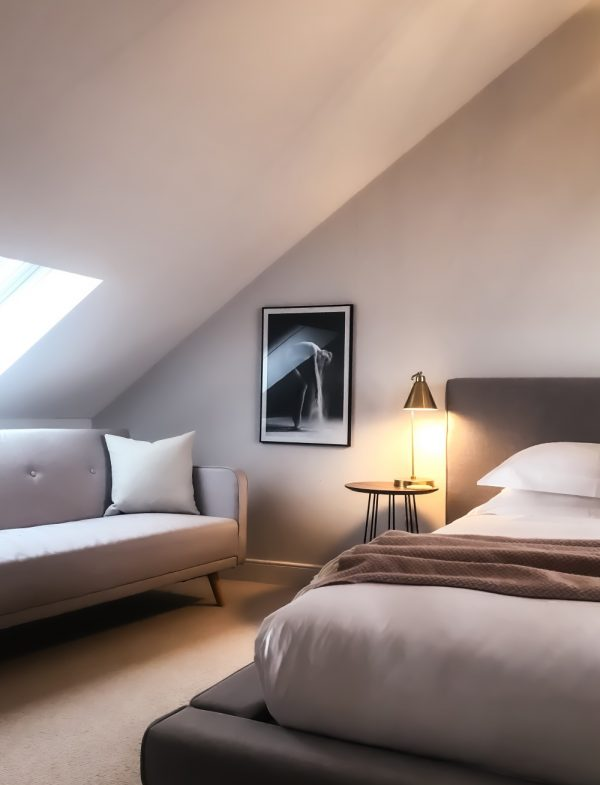 loft conversion showing window and bed